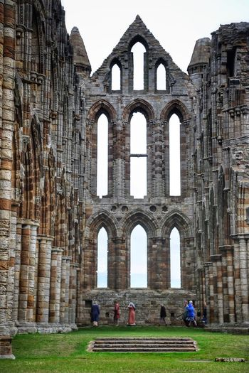 Whitby Whitby Whitby Abbey Architecture Built Structure History The Past Group Of People Building Exterior Real People Day Ancient Tourism Women Men Travel Destinations Sky Old Arch Adult Travel Old Ruin Building Outdoors Ancient Civilization Ruined Abbey Visit