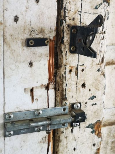 Old barn door makes for a good still life I say :) Old Barn Door Wood - Material No People Unedited Color Photo Textured Wood Barn Still Life Non-urban Scene Different Perspective Beauty In Ordinary Things Latch Hinge Full Frame Wood - Material Rusty Protection Textured  Old-fashioned Abandoned Door Closed Door Locked Entryway Entrance Padlock Entry The Mobile Photographer - 2019 EyeEm Awards My Best Photo
