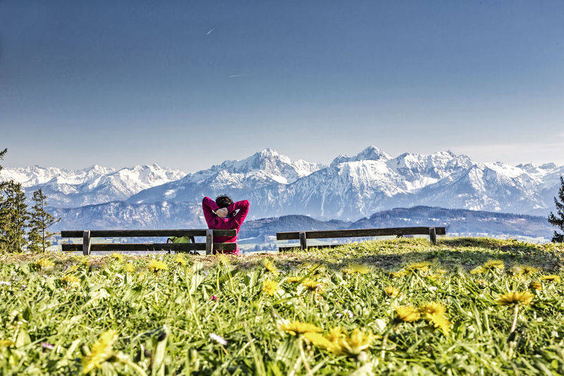 Rear view of woman looking at snowcapped mountains