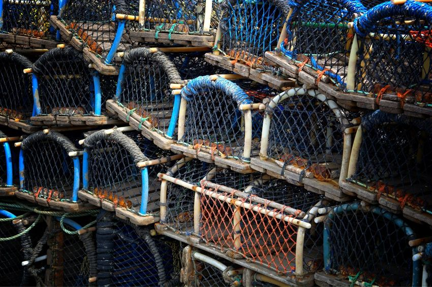 Lobster pots abstract Absrtact Abundance Arch Shape Arrangement Backgrounds Blue Commercial Day Development Fishing Trade Full Frame In A Row Large Group Of Objects Lifestyle Lobster Pots Mesh Natural Lifestyle Netting No People Outdoors Repetition Side By Side Still Life Weave Working Tools