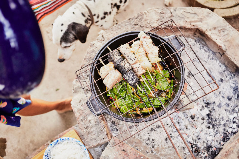 High Angle View Of Food On Barbecue Grill At Beach