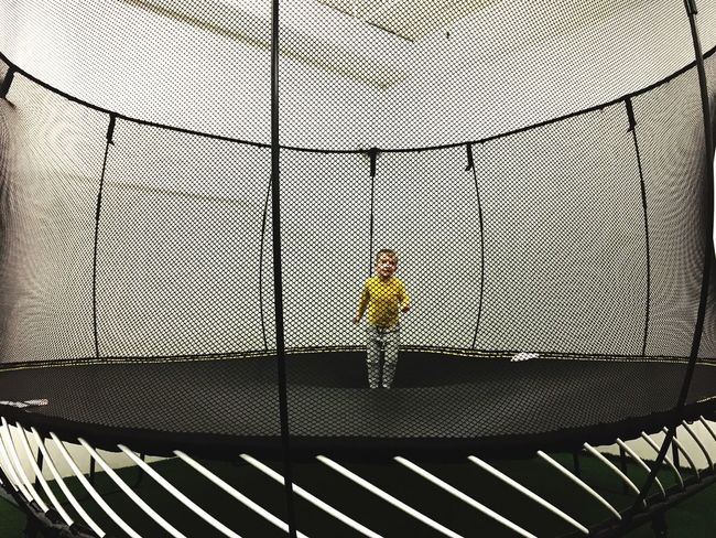 One Person Full Length Childhood Child Real People Jumping Jumping Child Trampoline People Indoors  Playground Big Trampoline Yellow Happy Child  Safety