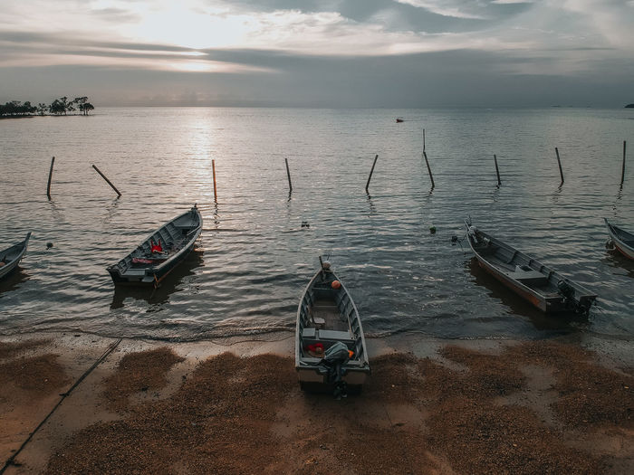 High Angle View Of Boats Moored On Sea Against Sky