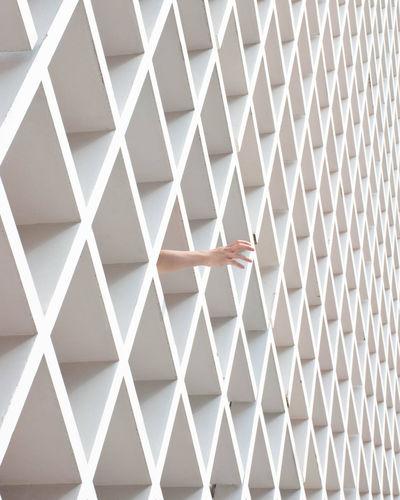 My hands are hidden in regular grids
