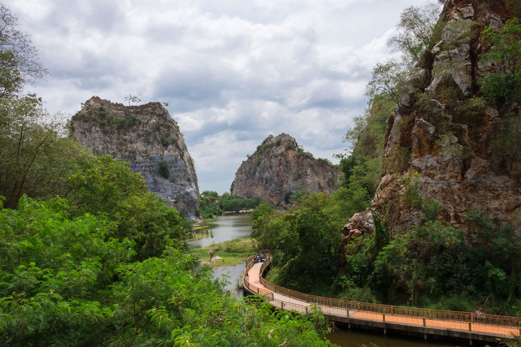 landscape view of the rocky mountains. with a bridge walkway and swamps. there are beautiful sky and clouds. nature conservation and ecotourism. travel adventure and vacation Ecotourism Adventure Attraction Backgrounds Bog Bridge Cliff Climbing Clouds And Sky Conservation Forest Hiking Holiday Island Landscape Mountain Natural Outdoors Park Thailand Tourism Travel Vacations Valley Walkway