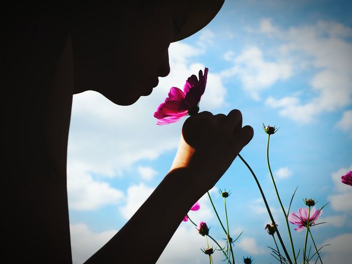 sense... Scence Sense Smell Aromatherapy Floral Sence Smell Blue Sky Woman And Flowers Flower Cloud - Sky Sky Human Hand Silhouette Human Body Part Day Outdoors Only Women One Person Close-up People One Woman Only Nature