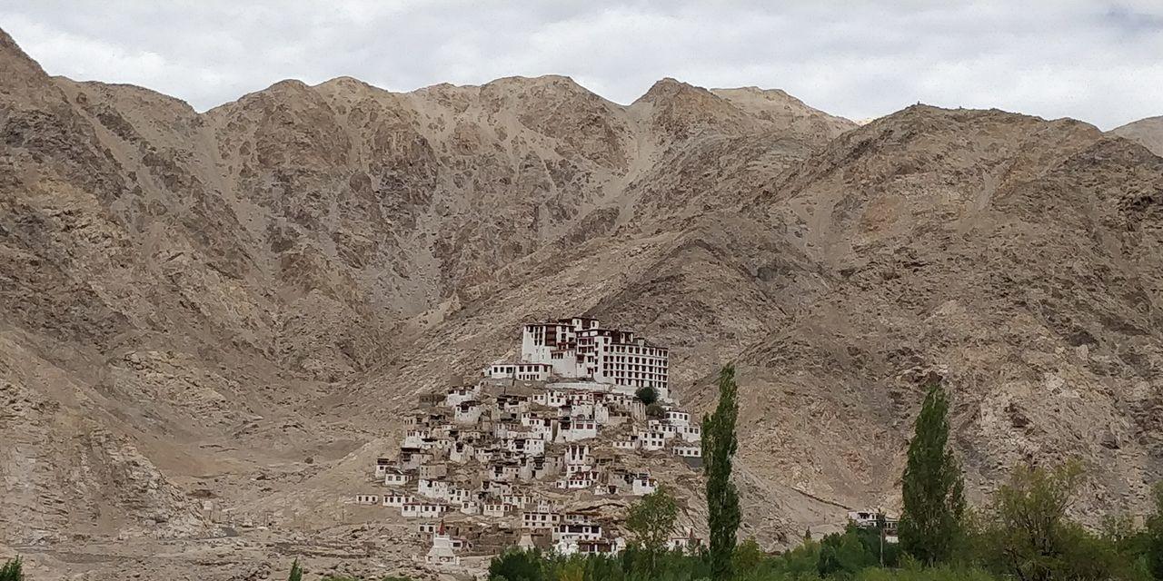 Buddhist Monestery.... Monestery Buddhist Mountain Range EyeEm Selects India Ladakh Bike Trip Mountain Text Sky Street Art Arid Landscape Physical Geography Rocky Mountains Rock Formation Eroded Desert