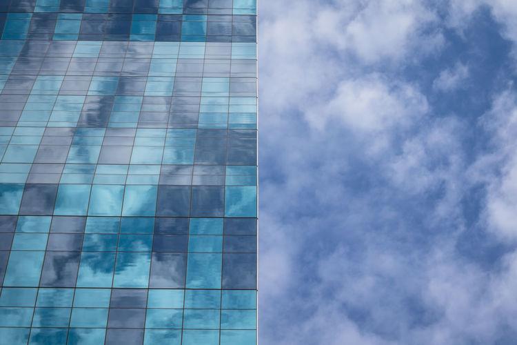 Digital composite image of modern building against sky