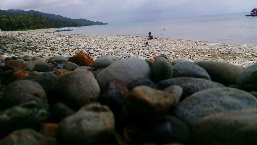 Kawat sa udto Philippines Playing Seashore Noontime  Vacation Solo Alone Playingtime Camsur Kinahologan, Lagonoy Go Higher Water Sea Pebble Sky First Eyeem Photo