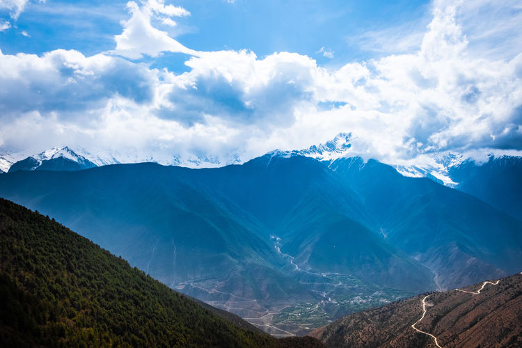 Mountain Scenics - Nature Beauty In Nature Cloud - Sky Sky Tranquil Scene Mountain Range Tranquility Environment Landscape Cold Temperature Non-urban Scene Snow Winter Nature No People Day Idyllic Snowcapped Mountain Outdoors Mountain Peak Mountain Ridge Meili DeQin Yunnan China Tibet Fog Cold Cool