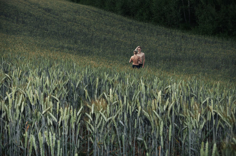 Couple standing in farm