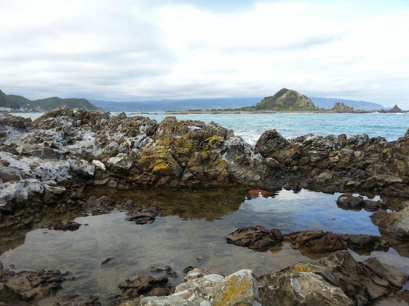 Reflections in the Rockpools at Island Bay with a rough Sea behind - Landscape