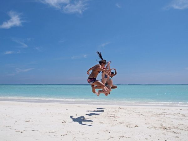 Jumping in Maldives Beach Sand Sea Sky Relaxation Vacations Summer Maldives Jump Jumping Heaven Island Island Life Happy Happy People Shadows & Lights Shadows And Sunlight