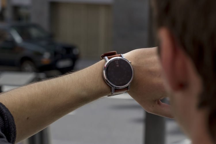 Cropped Image Of Man Checking Time
