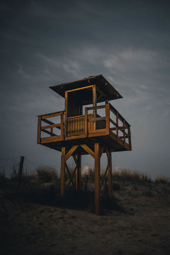 Lifeguard Hut On Sand Against Sky At Dusk