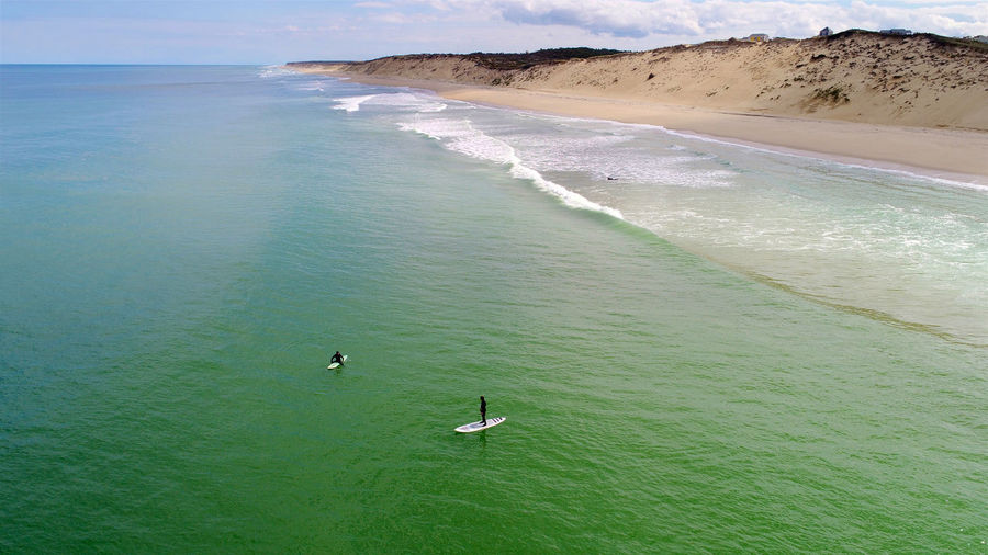 High angle view of people paddleboarding in sea