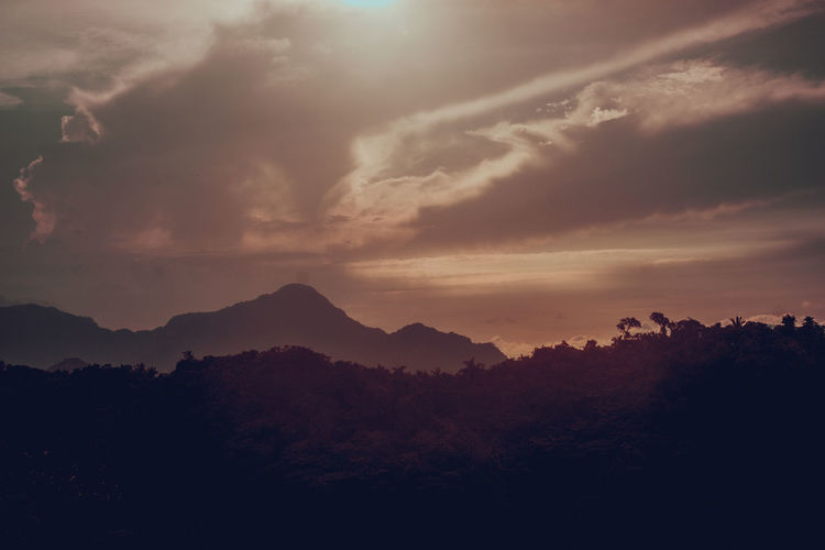 Scenic view of silhouette mountain against sky during sunset