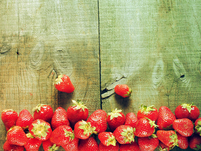 Directly above shot of strawberries on wooden table