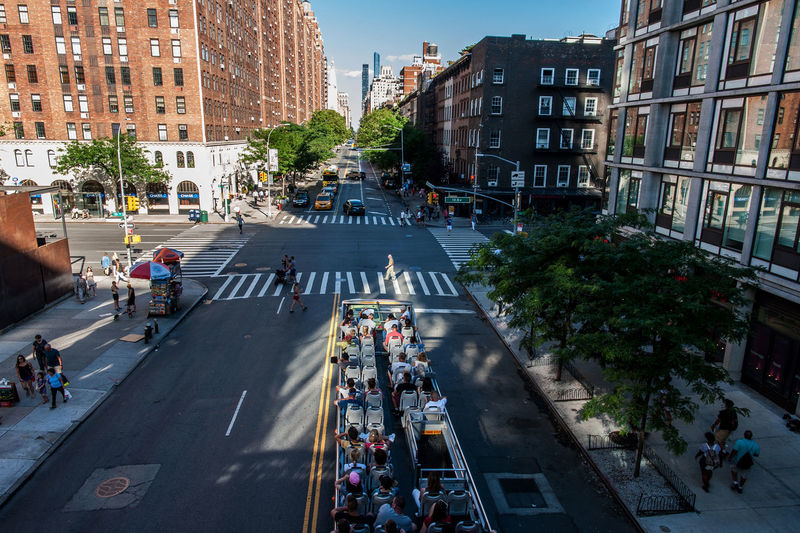 High Angle View Of People Sitting In Bus On City Street
