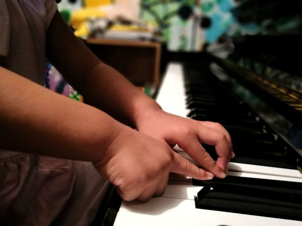 Richa first play piano Kids Human Hand Close-up Human Body Part Girl Piano Keys Piano Musical Instrument Music Kid Hand  People Connection Indoors  Only Women Piano Moments