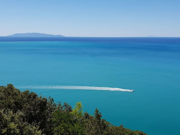 view sea island giglio spectacular view boat blu blue maremma Seaview Boat Blue Color Spectacular View Sea Giglio Island Vista Panorámica Mare Toscana Tuscany Panoramic View Nautical Vessel Beach Blue UnderSea Mountain Horizon Turquoise Colored Island