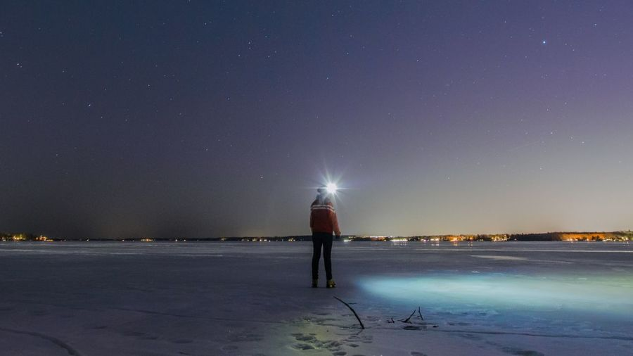 Night Star - Space Beach Sky Astronomy Long Exposure One Person Galaxy Sea People Sand Awe Full Length Outdoors Scenics Milky Way Water Beauty In Nature Break The Mold Shades Of Winter