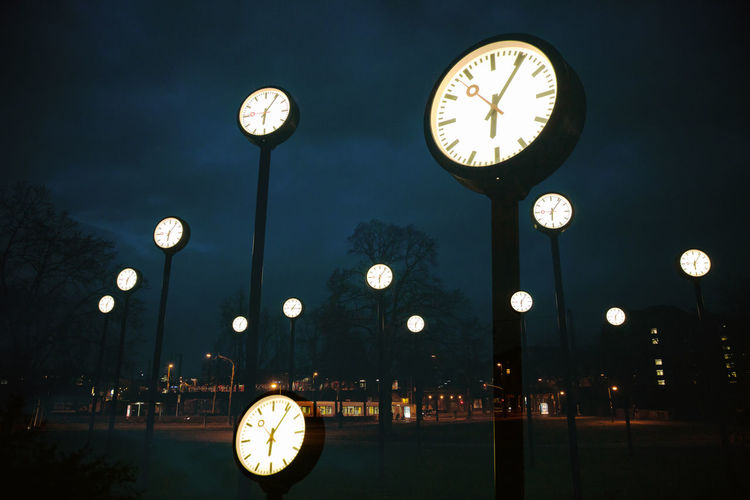 Low angle view of clock at night
