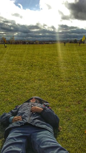 Earlier that day, it was rough. With the touguest loss in soccer game,(4-0) He decided to just lay and enjoy the beautiful Rays Of Sunshine . its weird, with sometimes just a pic, he teaches me so much about him and life. I adore him.(i also have to note that his team plays one yr up, so its no wonder its tougher for them. Sky Grass Green Color Field Scenics Landscape Beautiful Nature Nem Nature Nem Portraits NEM Landscapes NEM Mood NEM Boundlesslove EyeEm Nature Lover NEM Memories NEM GoodKarma NEM Clouds NEM Silence NEM Green Nem