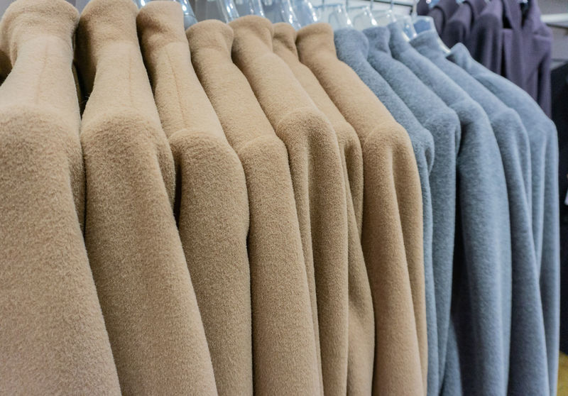 Mohair jacket on a clothes rack for the winter season Autumn Cardigan Fashion Knitting Mohair Jacket Winter Clothing Coat Rack Craft Jacket Mohair Goat Mohair Sweater Mohair Wool Natural Fibers Softness Velcro Warmth Winter Season Women Fashion Wool Woven