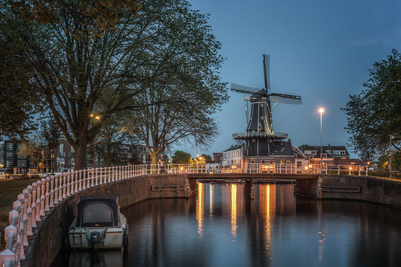 """View of traditional windmill """"de adriaan  at riverbank"""