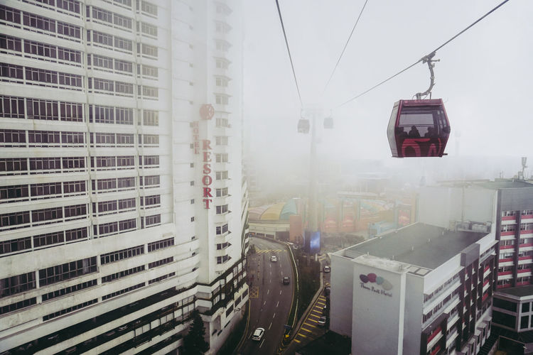 Low angle view of overhead cable cars in city