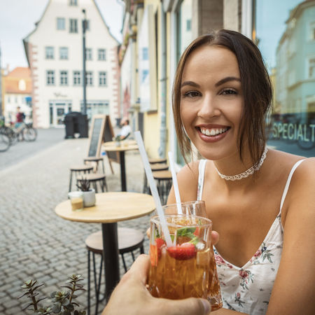 young woman having ice tea Dress Happiness Reflection Summer Exploratorium Beautiful Woman Brunette Girl  Cafe Caucasian Drink Enjoying Life Food And Drink Ice Tea Indoors  Looking At Camera One Person Outdoors Portrait Refreshment Smiling Straw Table Window Women Young Adult Young Adults