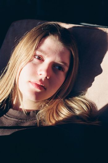 Thoughtful teenage girl resting at home
