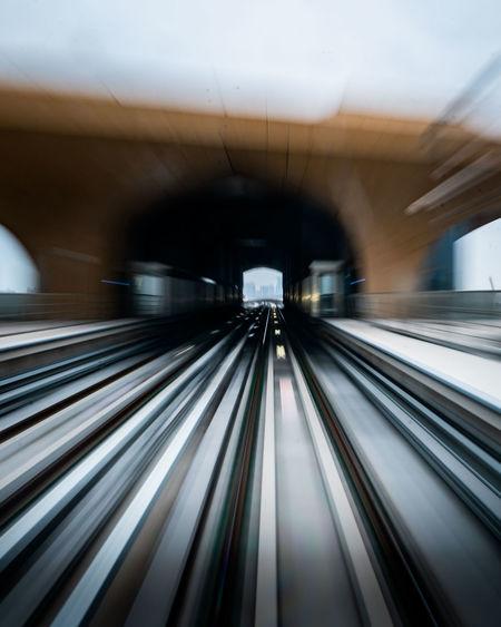 Blurred motion of railroad track at railroad station