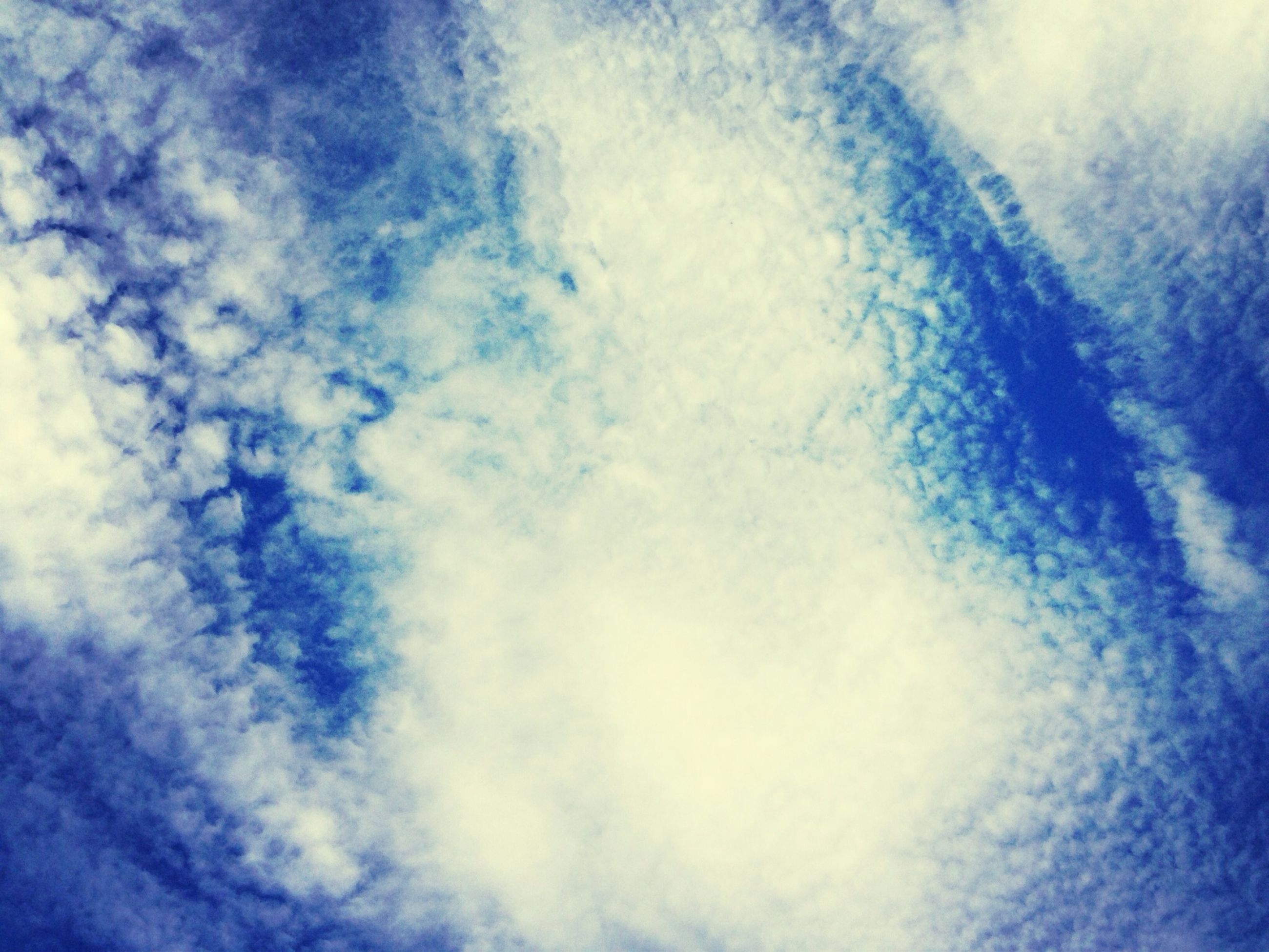 low angle view, sky, sky only, cloud - sky, backgrounds, full frame, beauty in nature, tranquility, cloudy, blue, nature, scenics, cloudscape, tranquil scene, cloud, white color, idyllic, weather, no people, outdoors