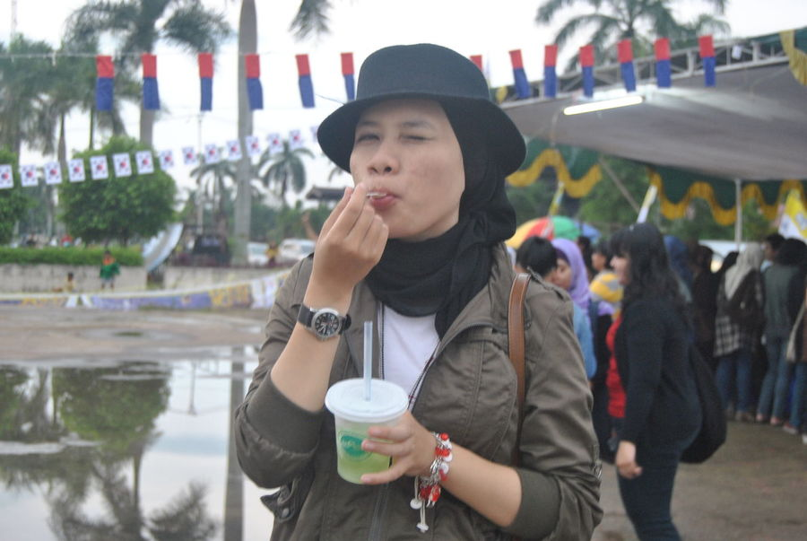 Drinking One Person Drink Front View Food And Drink Outdoors Day Adult One Woman Only Refreshment Knit Hat People Only Women Frozen Food Drinking Straw Arts Culture And Entertainment City Ice Cream Cone Cold Temperature Looking At Camera Potrait