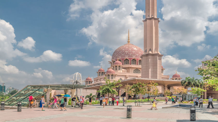 Putrajaya Malaysia Architecture Cloudy Holiday Putrajaya, Malaysia Square Tourist Attraction  Architecture Blue Sky Building Exterior Built Structure Cloud - Sky Crowd Dome Group Of People Mosque Nature Noon Outdoors Place Of Worship Real People Religion Sky Spirituality Tourism Travel Destinations