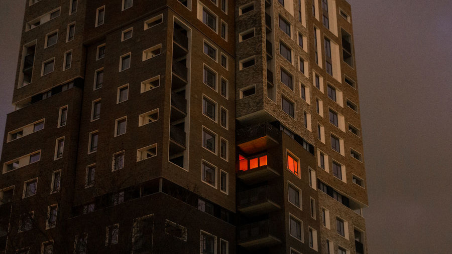 A window is illuminated orange in a block of apartment flats in Camberwell, London, England, United Kingdom. Built Structure Building Exterior Architecture Building No People Low Angle View City Window Red Outdoors Night Pattern Full Frame Brick Modern Communication Nature Wall Illuminated Apartment Residential Building Residential  Flat Apartment Buildings Minimalism Minimal Abstract Construction My Best Photo
