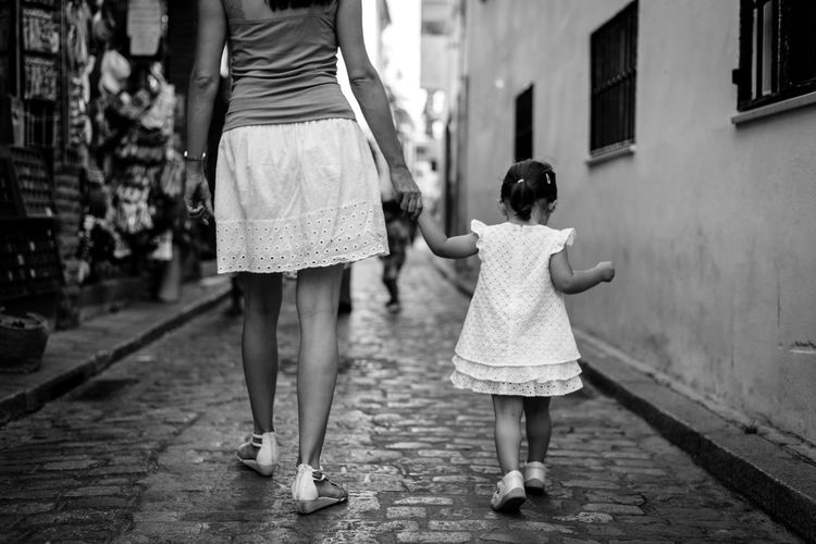 Mother walking hand in hand with infant girl in cute dresse through the streets of the old town of Cordoba, Spain Family Fine Art Photography Love Mother Old Town The Week On EyeEm Walking Around Black And White Child Childhood Fineart First Eyeem Photo Girl Outdoors Togetherness Walking Women This Is Family Moms & Dads