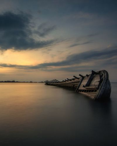 Sea Sunset Abandoned Water Horizon Over Water Night Outdoors Tranquility No People Nature Beach Sky Beauty In Nature Instanusantarajakarta Slowspeed Nature INDONESIA Longexposure Slow Shutter Speed Instanusantara Landscape Beauty In Nature Slowshutter Travel Destinations Cloud - Sky