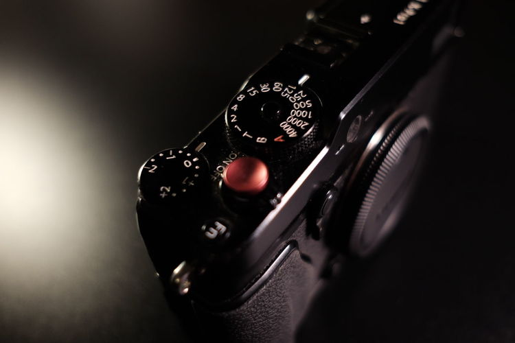 Close-up of camera over black background