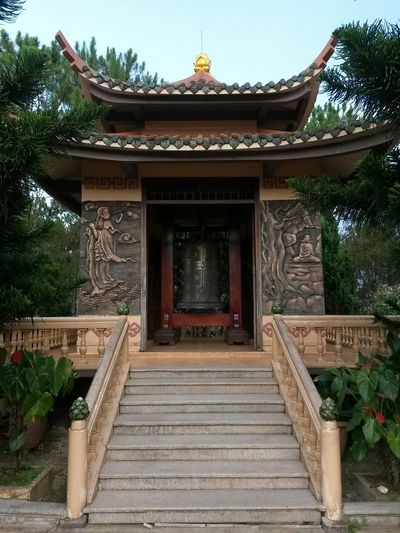 South East Asia Vietnam Architectural Column Architecture Belief Building Building Exterior Built Structure Day Entrance Nature No People Ornate Outdoors Place Of Worship Plant Religion Shrine Spirituality Staircase Steps And Staircases Temple Travel Destinations Tree