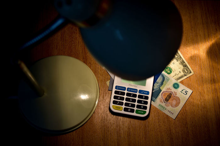 Lighting money. British Pound Notes Dollar Bill Economy Lighting Equipment Accounting Business Finance And Industry Calculator Capital Close-up Debt Crisis High Angle View Lamp Light And Shadow Lightning Money Little Money Money Money Around The World No People Saving Money Table Lamp Wood - Material
