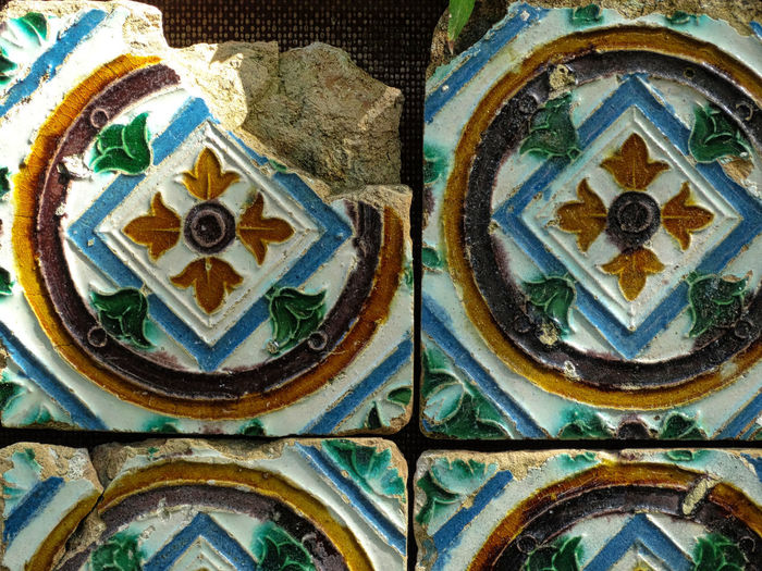 Tiles, broken. Art And Craft Full Frame No People Close-up Pattern Creativity Architecture Backgrounds Multi Colored Craft Wall - Building Feature Day History Design The Past Built Structure Blue Old Outdoors Ornate Mural Floral Pattern Tile Tiles