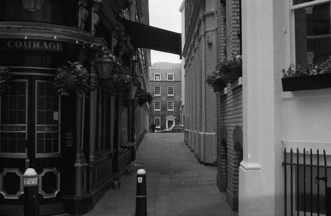 without fear 35mm Film Analogue Photography City Of London EyeEm LOST IN London Pub United Kingdom Alleyway Architecture B&w Street Photography Building Exterior Built Structure City Day Film Photography Filmisalive Filmisnotdead Monochrome One Person Outdoors Public House Tavern  Postcode Postcards