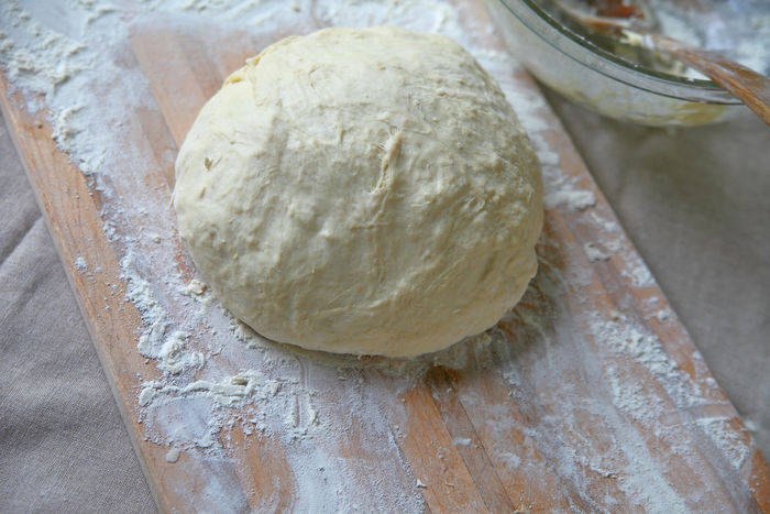 Bread dough on floured board Baking Bread Dough Close-up Copy Space Cutting Board Day Dough Ball Floured Board Food Preparation Home Cooking Homemade Food Indoors  Kitchen Scene Making Bread Messy Mixing Bowl Natural Light No People Studio Shot Text Space Textures