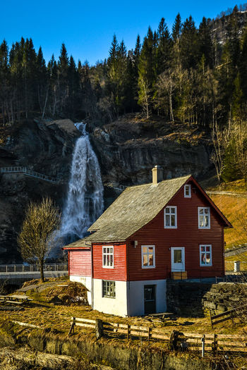 Steinsdalsfossen behind a local farmhouse, Norheimsund, Norway Nature Tourist Attraction  Architecture Beauty Building Exterior Built Structure Cascade Cataract Day Fall Landscape Motion Nature Outdoors River Sky Water Waterfall
