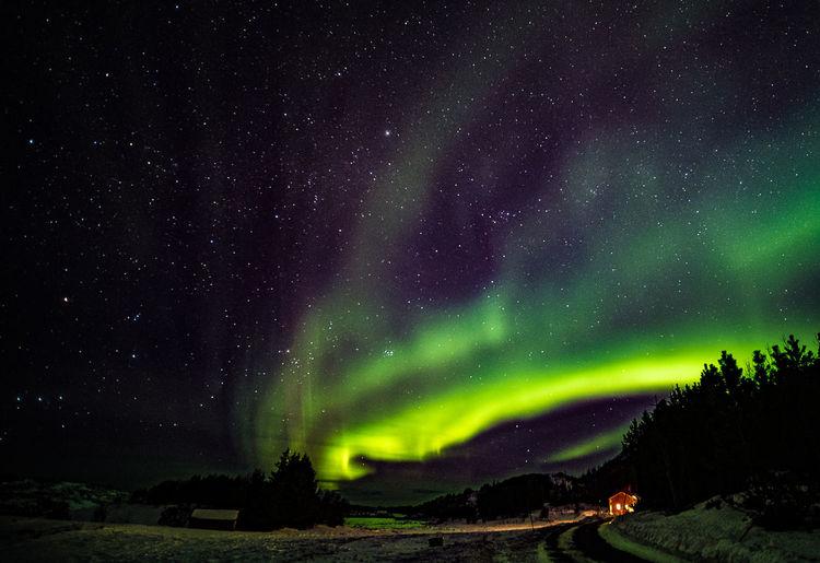 Aurora polaris over land at night