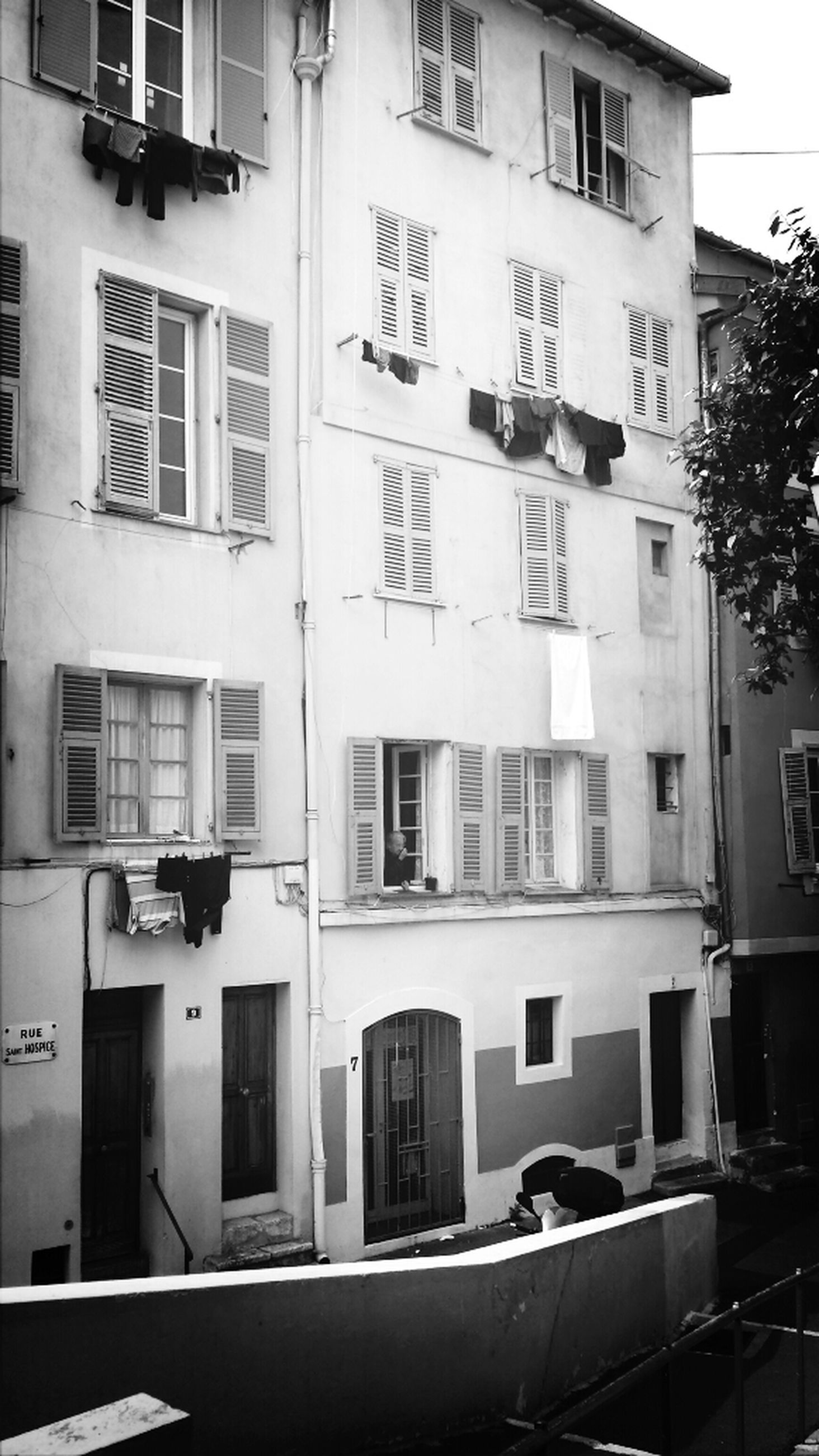 building exterior, architecture, built structure, window, residential building, building, city, residential structure, apartment, balcony, in a row, day, no people, house, outdoors, facade, glass - material, street, city life, car