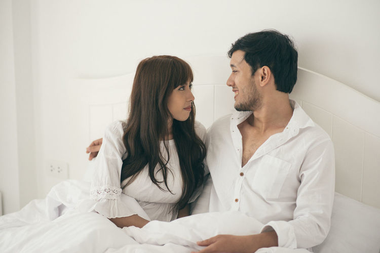 Adult Bonding Couple - Relationship Domestic Room Emotion Females Furniture Heterosexual Couple Indoors  Lifestyles Love Men Positive Emotion Togetherness Two People Women Young Adult Young Men Young Women